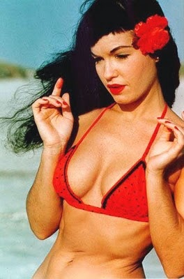 Bettie Page, circa 1960. Love how muscular she was.