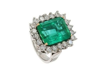 CLUSTER RING, 18K white gold, emerald cut emerald from Colombia approx 10,60 cts, GCS certificate No 5776-7044 (London), 20 brilliant cut diamonds approx 2,00 ctw, approx TW-W/VS-SI, size 17,25 mm, weight 14,4 g. #ring #emerald #jewelry