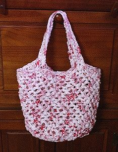 "This bag has been pronounced, ""the ultimate recycled market bag"" by one of the managers at my local HEB supermarket, from which the plarn was obtained. Plarn is made from cut-up plastic bags, and this pattern uses those ubiquitous plastic grocery store bags. It is very strong and long-lasting. In fact, after years of use, mine are still performing admirably."