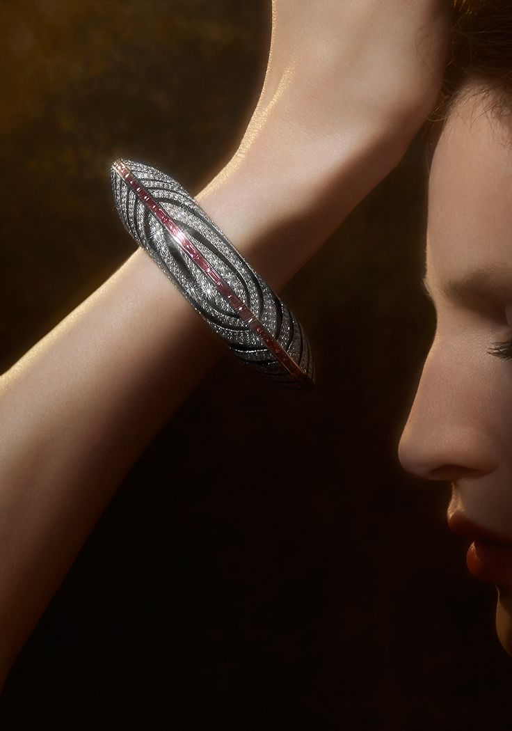 The 'Zebra' high jewellery bracelet from the L'Odyssée de Cartier Parcours d'un Style collection, in white gold with onyx, garnets and diamonds.