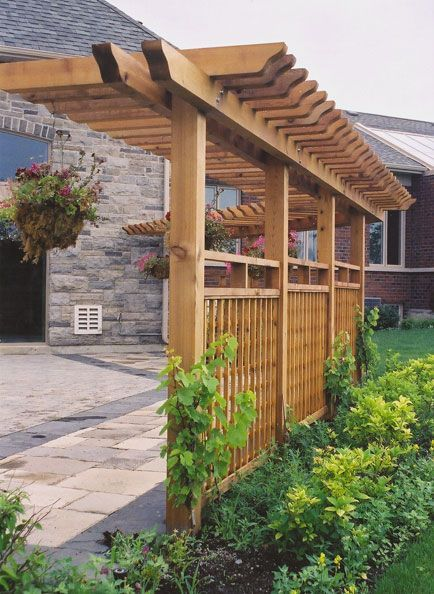 You see pergolas/arbors attached to houses which always seems cluttered. I love the idea of having a freestanding pergola/arbor...this one along walkway to front door. This really opens up the possibilities...