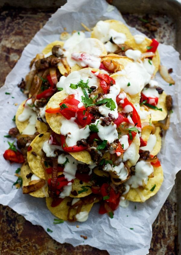 italian style nachos layers of spicy italian sausage roasted red peppers fontina cheese and a creamy italian sausage stuffed peppers turkey italian sausage italian style nachos with provolone cheese sauce turkey sausage and roasted red peppers