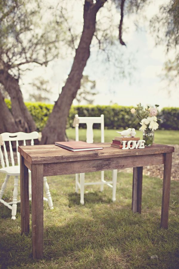 This rustic wooden signing table is stunning, some flowers and mason jars complete a very contemporary look.  Perfect for making the perfect day official.