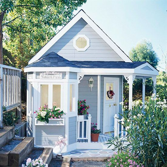 Delightful details dress up this playhouse. A portal window up top brightens the interior of a playhouse.