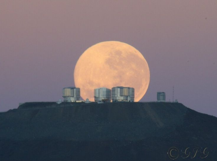 Moonset at Parnal Observatory in Chile, site of the Very Large Telescope--four networked telescopes operating in tandem.