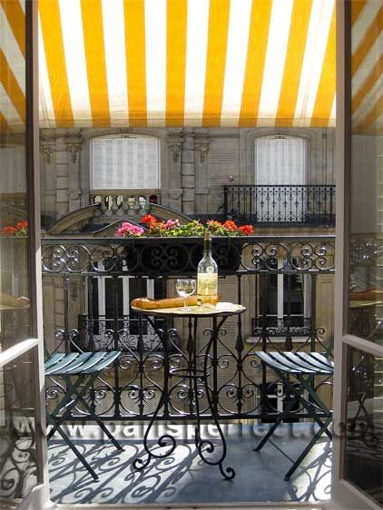 A cute, typically Parisian iron apartment balcony, with a brightly colored striped awning and romantic seating for two. Naturally, being in Paris, the table is laid with wine and a crusty baguette. :): Sports Cars, Paris Apartments, Balconies, Sunny Day, Wrought Iron, Yellow, Places, Stripes, Patios