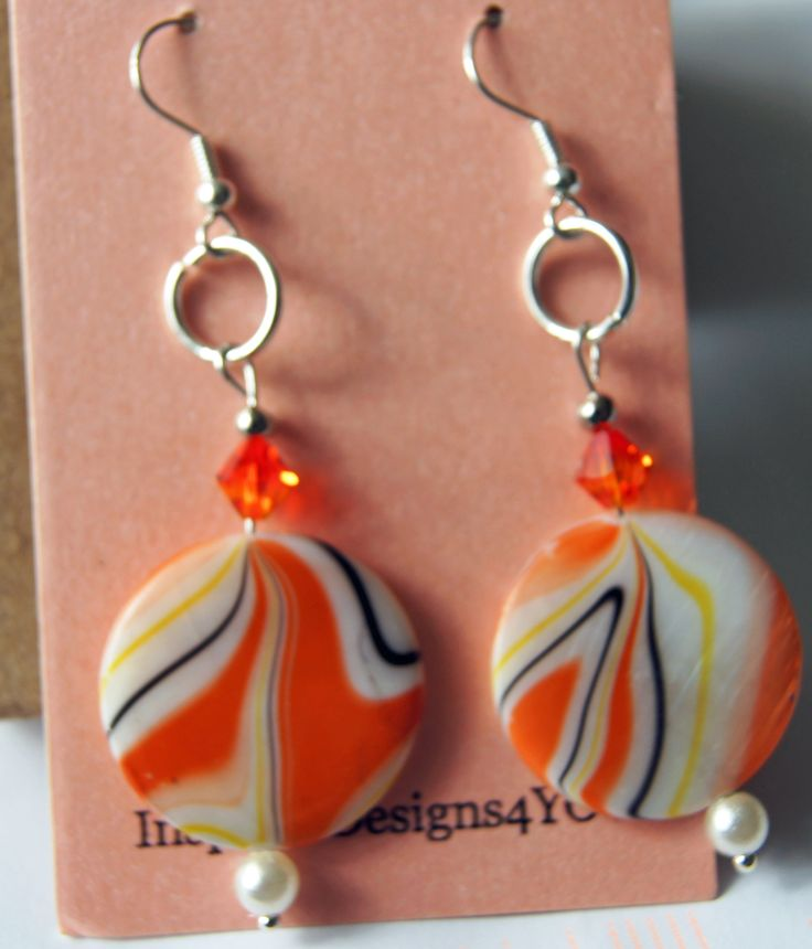 Inspiration from the 1960, the art, geometric patterns, the fashion, orange popsicles, floats all come together in the design for these earring. Designed by me in my home studio.