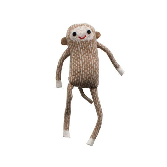 A cuddly baby monkey made from lambswool.