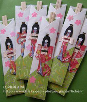 Japanese paper dolls with waribashi-disposable chopsticks. via flickr