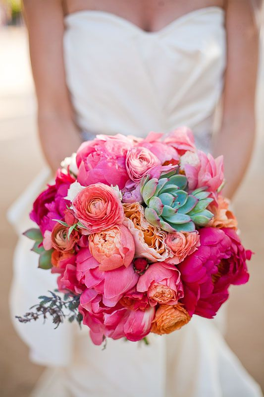 Vibrant pink, peach, and green bouquet.