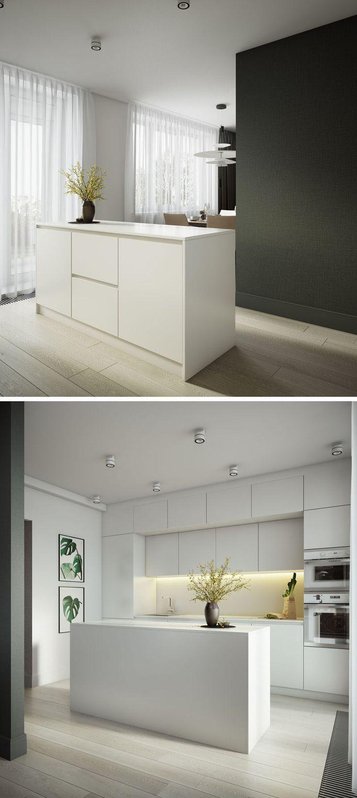This modern apartment has a bright white kitchen with hardware-free cabinets. #ModernKitchen #WhiteKitchen