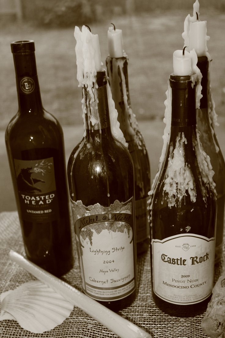 I used my old wine bottles as candle holders for outside for Ideas for old wine bottles