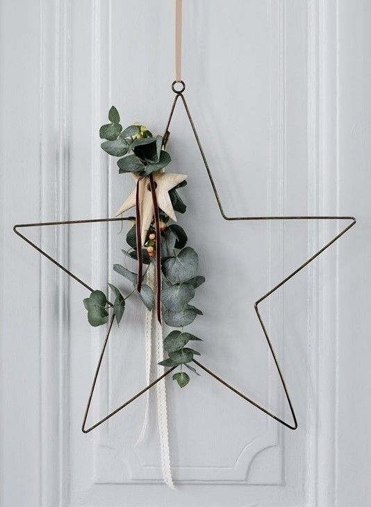 simple metal star dressed with a branch of evergreen