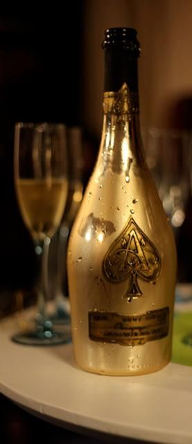 "Armand de Brignac ""Ace of Spades"" Brut Gold Champagne in a gold pewter bottle.  Beyonce sings  about Armand de Brignac in her song ""Drunk in Love."""