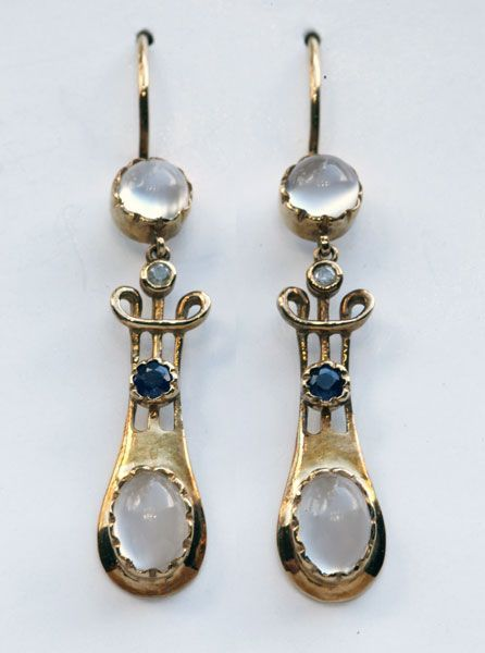 Earrings of gold, moonstone, sapphire and diamond. Sold by Murrle Bennett and Co., London, 1896-1916.