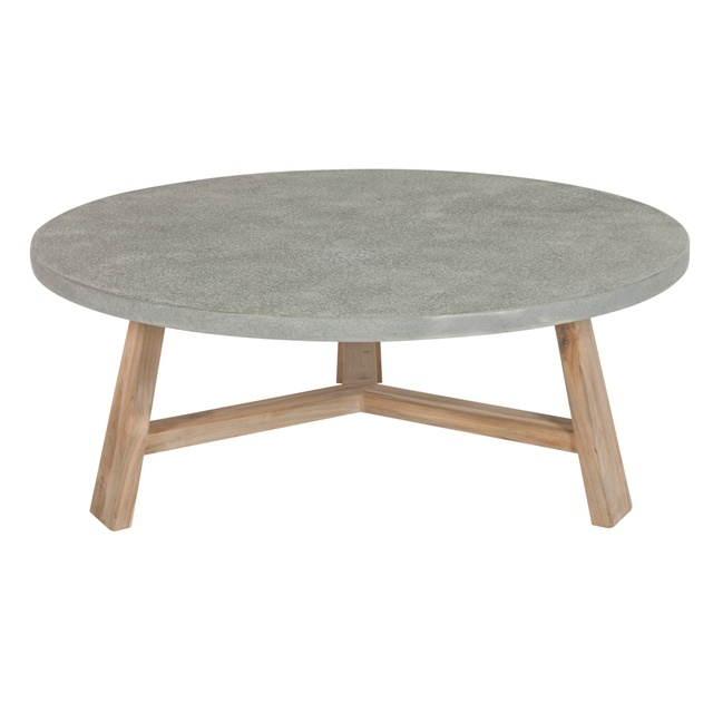 Round Concrete Coffee Table Could build one like this with a shelf underneath