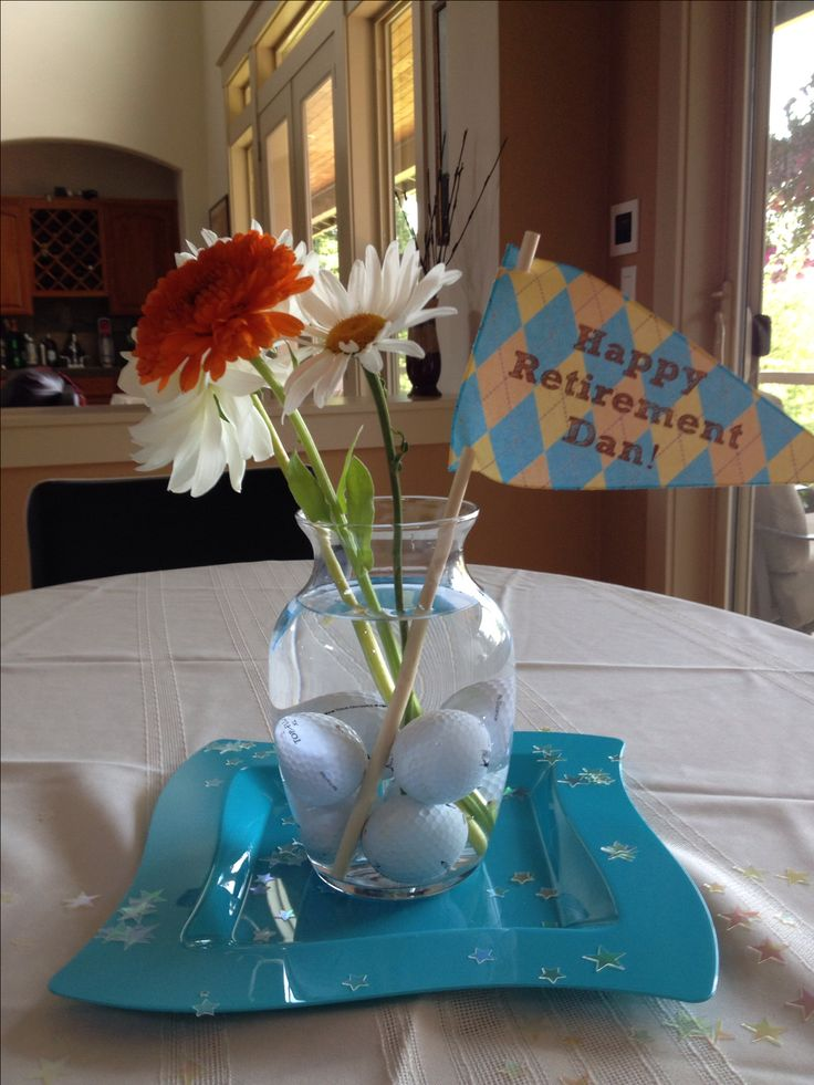 Happy retirement party!  Great centerpiece idea using golf balls and flowers…