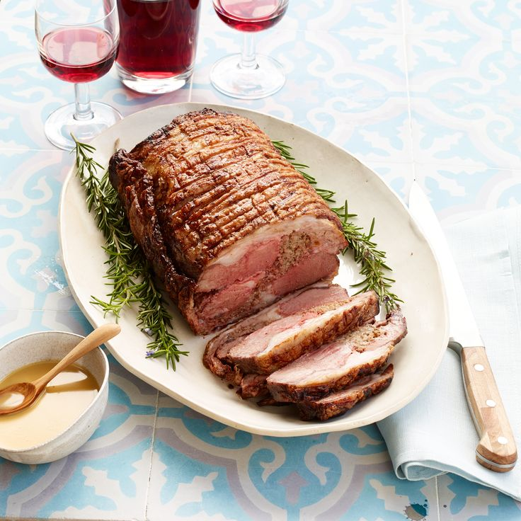 Lamb Roast with Mustard Pan Sauce - In this twist on traditional porchetta (Italian roast pork), a boneless saddle of lamb is wrapped around a delicious filling of GROUND LAMB and fennel. The stuffing mixture is very versatile; use the leftovers for all kinds of dishes. | Food & Wine
