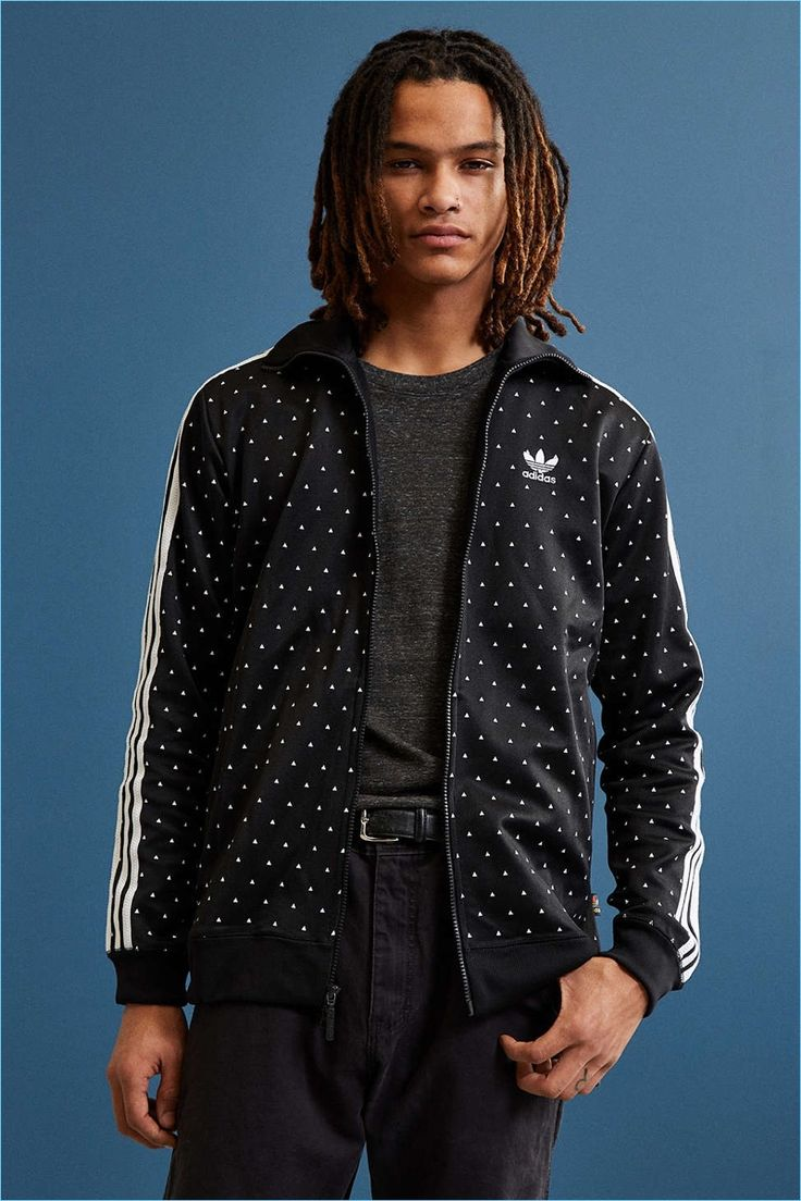Adidas collaborates with singer and designer Pharrell Williams on a special triangle print men's track jacket.