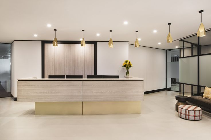 X-Bond Seamless Stone BI finish in Blanco throughout reception floor to create a continual seamless surfaces.