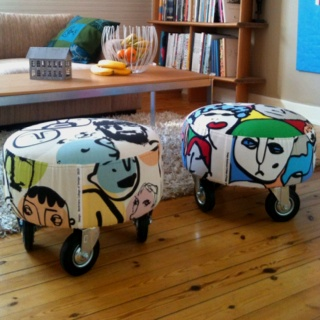 I NEED THESE... !!!!!    20 y.o. stools from Ikea almost thrown away... but with new fabric       and a bunch of industrial wagon wheels they do just fine à few more years.