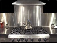 Simple cut-to-order stainless steel backsplash panels for behind stove