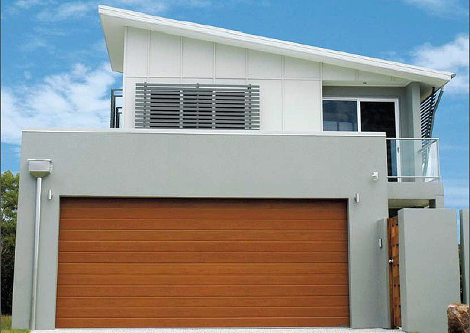 rendered brick with timber roller-door