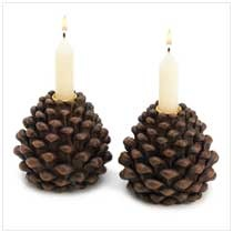 """No matter the time of year, these rustic candleholders shed just the right light on your favorite occasions! Each lifelike pine cone holds a tall, slender taper candle to create a friendly festive glow. Weight 1 lb. Polyresin. Candles not included. Each is 4"""" diameter x 3 3/4"""" high. Pair                     Item:  14151    Price: $19.95  My Price: $11.97  (40% Off)"""