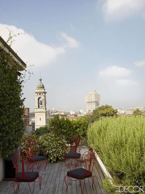 Milan terrace, planted with jasmine and rosemary, offers a view of the 16th-century Chiesa di San Barnaba e Paolo and the 1950s Torre Velasca.