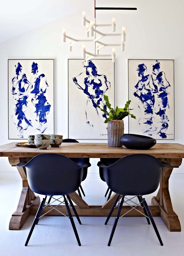 eclectic dining room in blue and white with natural wood table