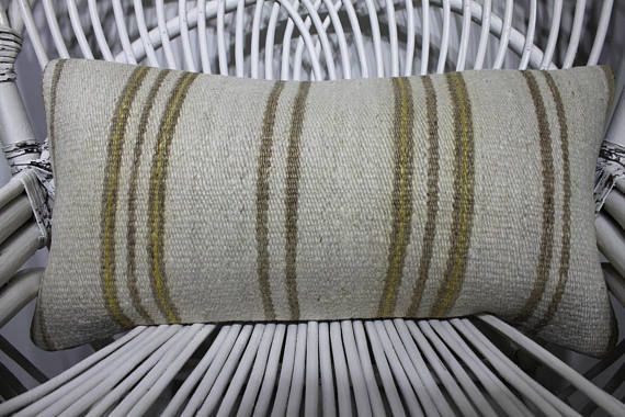 white and yellow color striped kilim pillows worn