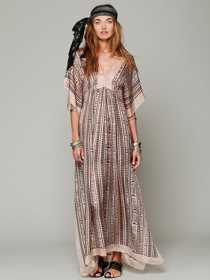 "Lotta Stensson Ikat Print Maxi Kaftan at Free People Clothing Boutique Ikat printed silk maxi kaftan with ""V""-neckline in front and back. Pretty and bohemian oversized fit. Makes for a gorgeous beach cover up or going out dress.   *By Lotta Stensson *100% Silk  *Dry Clean Only  *Import"