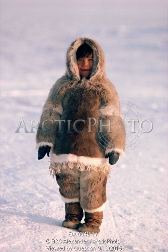 Image of inuit girl wearing traditional caribou skin clothing and sealskin boots. baffin is., nunavut, canada. by ArcticPhoto