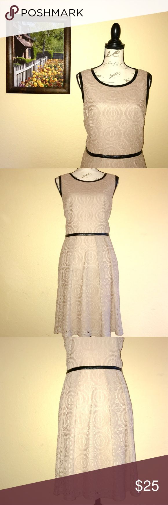 Leather & Lace Dress Tan lace dress with black faux leather trim. Keyhole closure in back and side zipper. The is a little bit of pilling from a sweater worn over dress under one arm. Otherwise, great used condition. Pet and smoke free home. Modcloth Dresses Midi