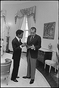 Sammy Davis, Jr. in the Yellow Oval Room of the White House with President Richard Nixon, March 4, 1973. Nixon invited Davis to sleep in the White House in 1973, which is believed to be the first time an African American was invited to do so. Davis spent the night in the Queen's Bedroom.