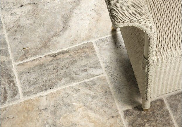 With a brushed and chipped edge, the Silver Brushed Travertine ranges in colour from off-white and pale beige to darker grey with distinct marbling, pitting and quartz detail.