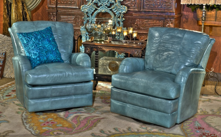 """Robin's Egg Blue Recliners:    Whether a matching pair or just one this fabulous leather recliner is butter soft. Not only does it recline, but this chair swivels as well, making conversation with anyone in the room easy.     39"""" T x 34"""" W x 20"""" seat depth  www.brumbaughs.com"""