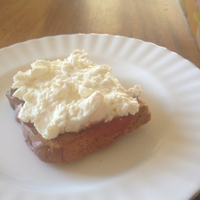 Treat Breakfast or Morning Tea. 216cals. 6gProtien. 40gCarbs. GF raisin toast with strawberry jam and cottage cheese.
