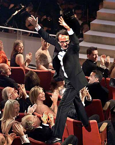 Roberto Benigni winning the oscar for the best movie-love him!!! Never forget watching him win.