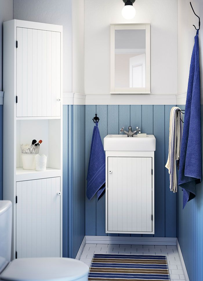Ikea 2014 Fall (beadboard) A small bathroom with a white wash-basin cabinet, a corner cabinet and a mirror