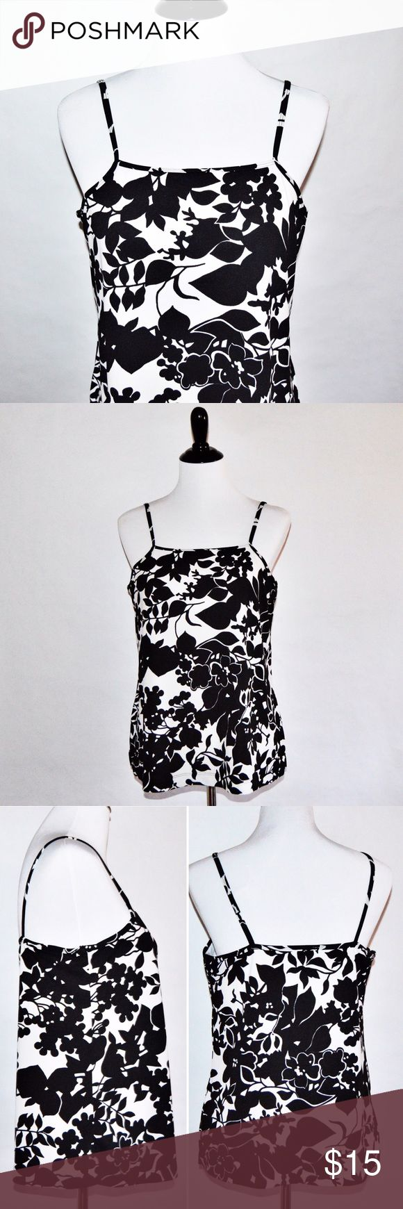 "Floral Black & White Tomorrow's Mother Cami / Top Floral Black & White Tomorrow's Mother Cami / Top  Great cami or top for during and after pregnancy. Stretchy and very pretty. Elastic band under the built in bra coming out in one side. The tag is missing so I don't know what it's made out of or the size but I'm guessing a M/L  Measurements Chest:17"" across / 34"" around, Length:25""  🔆Bundle 2 items = 10% OFF 🔆Bundle 3 or more = MAKE OFFER ❌ No Trades Tomorrow's Mother Tops"
