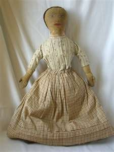 19th C rag doll in early brown calico .