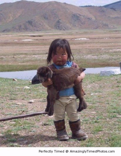 Kid carrying a kid – When a little one needs a lift, just call in another to help.
