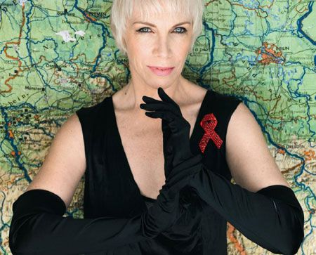 Annie Lennox constantly wears HIV Positive t-shirt while busy in her advocacy against HIV AIDS virus. She works for both Nelson Mandela's 46664 campaign and TAC, the human rights groups. The groups focus on health, prosperity and education of HIV AIDS virus affected people.