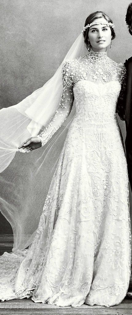 Lace wedding gown vintage with long sleeves.
