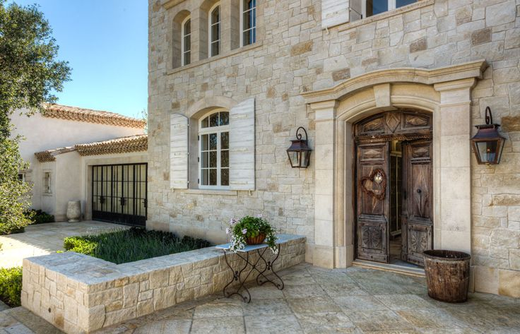 French Country Provençal Gustavian Style Home exterior with reclaimed stone and antique doors. #frenchcountry #exterior #bastide #stonehouse #provence