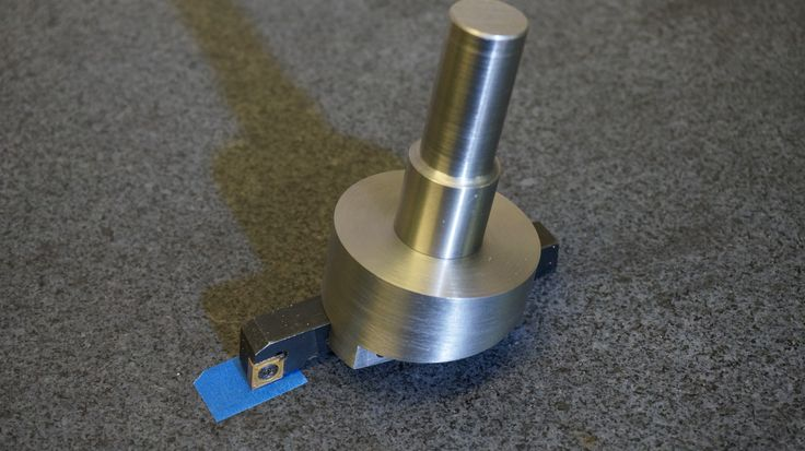 CCW Fly cutter for use with right-hand lathe carbide tool holders. https://www.youtube.com/watch?v=jzDYecfLnZ4&t=1s