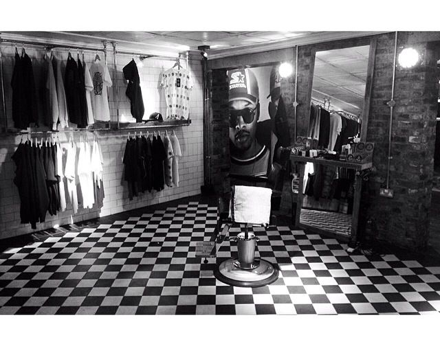 Cool barbershop set up, with AONO clothing stocked up. Black and white floor tiles and single station set up with Uppercut Deluxe.   Barbershop ideas.