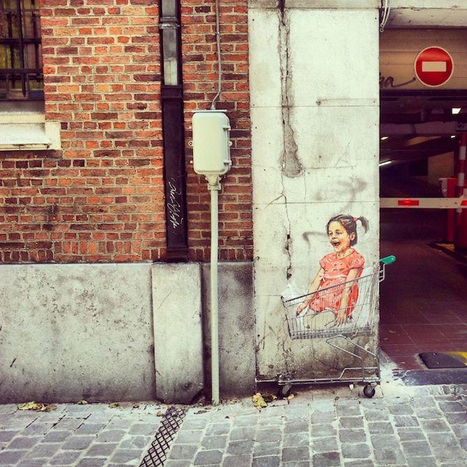 Street art by Ernest Zacharevic http://restreet.altervista.org/ernest-zacharevic-street-artist-che-unisce-reale-e-irreale/
