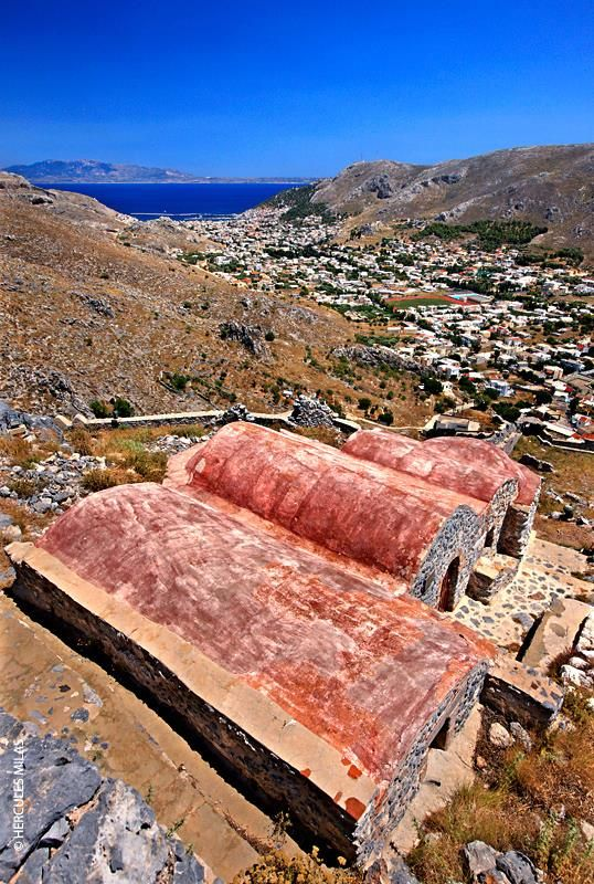 "The ""twin"" churches of the Dormition of Virgin Mary  Saint Nicholas (15th-16th century), at the castle of Chora, Kalymnos island, Dodecanese, Greece. In the background, Pothia town. #kitsakis"